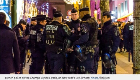 French police on the Champs-Elysees, Paris, on New Year's Eve. (Photo: ninara/flickr/cc)