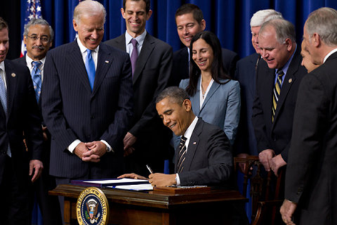 President Obama signing Executive Order 13691 which bans the sale of assault weapons and places a mandatory 30 day waiting period on all firearm sales. (AP Photo/ Dennis System)