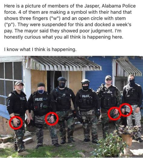 hand sign racist police slavery white supremacy Michael Hammond