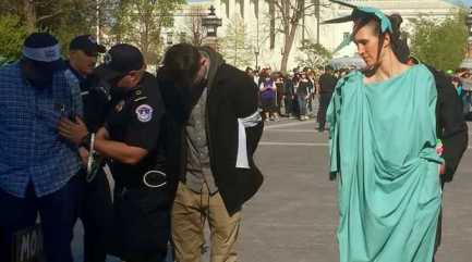 lady-liberty-getting-arrested